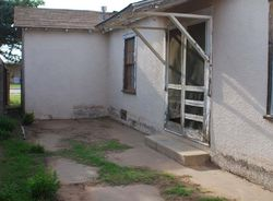 W 14th St, Portales, NM Foreclosure Home